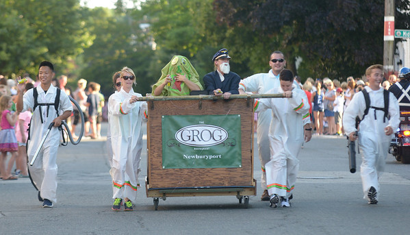JIM VAIKNORAS/Staff photo. The Grog chose a Ghost Busters themed bed as they run down Federal Street in the annual Lions Club Bed Race.