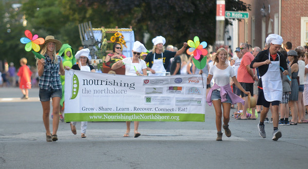 JIM VAIKNORAS/Staff photo. Nourishing the NorthShore makes it's down Federal Street in the annual Lions Club Bed Race.