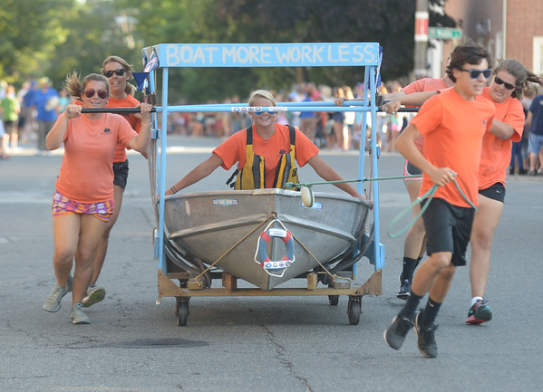 JIM VAIKNORAS/Staff photo. The Newburyport Marina's bed floated/ran down Federal Street in the annual Lions Club Bed Race.