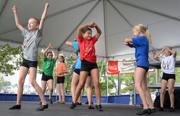 """Bryan Eaton/Staff photo. Youngsters from Kathy's Tumblewee dance studio perform """"We Are Family"""" at the Yankee Homecoming Kids Talent Showcase."""