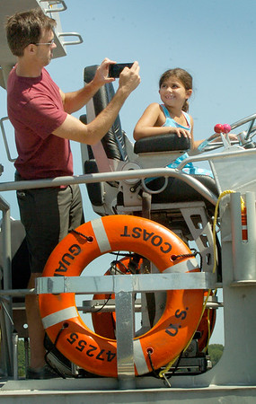 BRYAN EATON/Staff photo. Zach Legein of Minneapolis takes a photo of his niece Alexi Legein of Old Lyme, Conn. aboard one of the motor lifeboats at the U.S. Coast Guards Open House. His mother, Pat Iris, moved to Newburyport in the early 1980's.