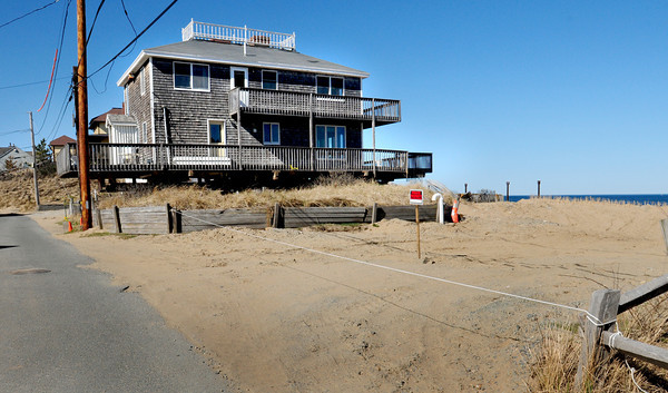 Newbury: 29 Annapolis Way on Plum Island remains jacked up. Bryan Eaton/Staff Photo