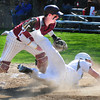 Newburyport: Pentucket's Connor McGuirk scores a run past Newburyport catcher Connor Wile on a triple by Jake Bourdiano. Bryan Eaton/Staff Photo
