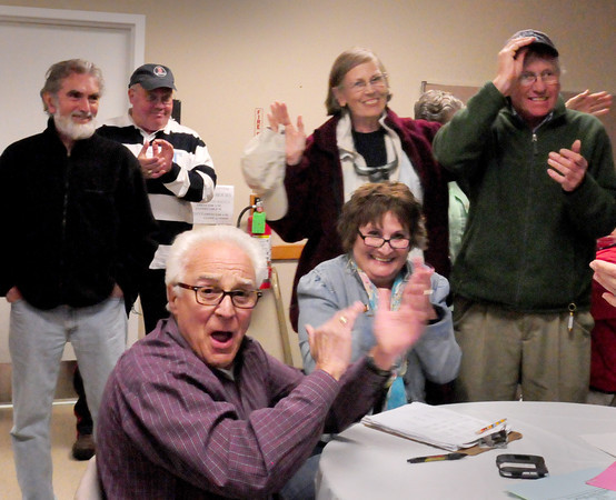 Salisbury: People applaud the ballot question for a new library which passed last night, though still has to pass at Salisbury town meeting. Bryan Eaton/Staff Photo