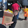Newburyport: With a box almost as big as he is filled with food, Donovan Landry, left, and his brother drop off several boxes of food at the Pettengill House Food Pantry in Salisbury with the help of their dad, Sean. The younster, who turned 9 this past weekend, asked people who attended his birthday to bring food instead of presents. Bryan Eaton/Staff Photo