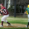 Newburyport: Newburyport first baseman Andrew Fiascone has the ball in hand forcing out the North Reading runner. Bryan Eaton/Staff Photo