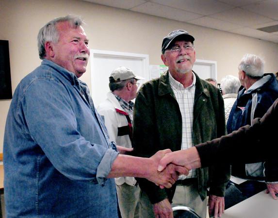 Salisbury: Freeman Condon, left, who won a seat on the Salisbury board of selectman last night, is congratulated along with Ed Hunt who won reelection. Bryan Eaton/Staff Photo