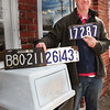 Amesbury: Sean Devlin has found several old Massachusetts auto tags in his travels. Bryan Eaton/Staff Photo