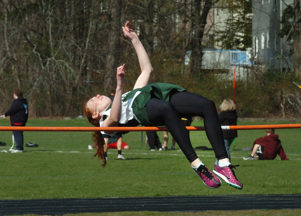 Newburyport: Pentucket's Charlotte Carroll competes in the high jump against Newburyport. Bryan Eaton/Staff Photo