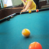 Newburyport: Trinity Gardel, 12, tries her luck in a game of pool with her friend Beckett Reap, 12, Wednesday. They were at the Kelley School Youth Center. Bryan Eaton/Staff Photo