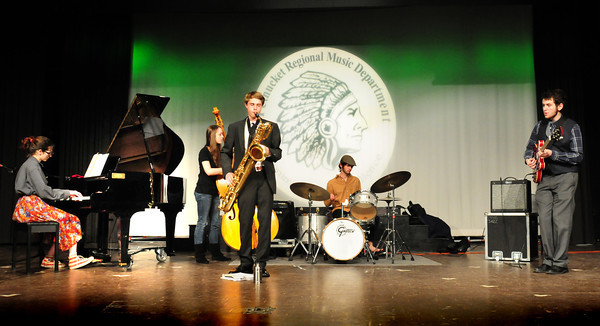 "West Newbury: One of the performances at the Pentucket High School Auditorium Recognition Celebration was one of Nina SImone's ""4 Women"" by Emma Jones with Jazz Combo. From left, on the new piano, Emma Jones, Aubrey Harris, Alden Slack, Eddie Gaudet and Josh Torvi. Bryan Eaton/Staff Photo"