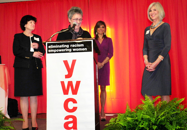 Newburyport: The YWCA's Jean Berger recognizes the organization's Community Champions, Charlene Dolan, left, and Nancy McCarthy, right. At rear is Boston TV news personality and honorary chair, Maria Stephanos. Bryan Eaton/Staff Photo