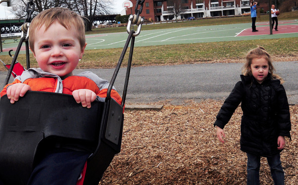 Newburyport: Connor Minor, 18 months, gets a push on the swingset by his sister, Victoria, 4, at Cashman Park on Monday. The two, from East Boston, were visiting their great-uncle John Donovan of Plum Island. Bryan Eaton/Staff Photo