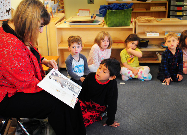 "Newburyport: Local author Laurie Collins reads her book ""The Pajama of My Dreams"" to youngsters at the Newburyport Montessori School on Thursday. She was there for their Pajama Day in conjunction with the Parent Association's Pajama Drive. Bryan Eaton/Staff Photo"