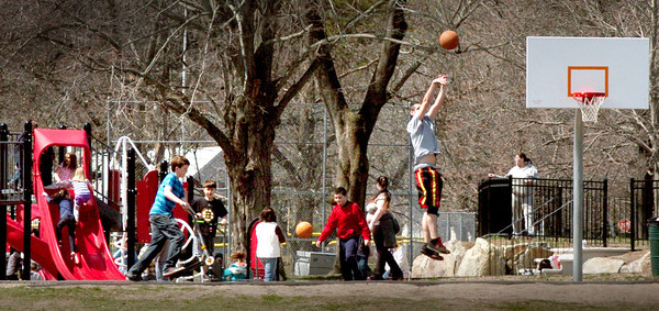 Amesbury: With schools out for vacation and temperatures in the 60's, there was a good crowd of youngsters playing at Amesbury Town Park on Tuesday. Bryan Eaton/Staff Photo