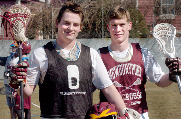 Newburyport: Nick Mombello, left, and Alex Buckley on the Newburyport High lacrosse team. Bryan Eaton/Staff Photo