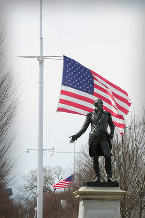Newburyport: Flags at the Bartlet Mall and in front of Newburyport Superior Courthouse, back, are at half staff in respect for the victims of the bombing at Monday's Boston Marathon. Bryan Eaton/Staff Photo