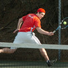 Amesbury: Amesbury's Grant Bellino in second singles action against North Reading. Bryan Eaton/Staff Photo