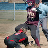 Newburyport: Newburyport's Lauren Bean gets tagged out by the North Andover shortstop on a steal attempt. Bryan Eaton/Staff Photo