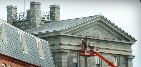 Newburyport: The Custom House Maritime Museum in downtown Newburyport is getting the south and west sides of the granite building repointed, part ongoing significant renovations. In June a new roof will be installed on the observatory where the flagpole sits, upper left. Bryan Eaton/Staff Photo