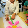 Salisbury: Haley Smith, 6, creates a spring flower, though Tuesday seemed like anything but spring with cold weather and wind. The kindergarter was in Pauline Carrier's class at Salisbury Elementary School. Bryan Eaton/Staff Photo