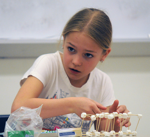 Amesbury: Makayla Vigneaux, 9, builds a structure out of toothpicks and marshmellows at Amesbury PTA Science Fair at Amesbury high school Saturday. Elementary School kids presented 55 projects at the fair. Jim Vaiknoras/staff photo