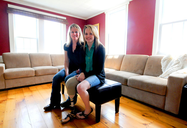 Amesbury: Paige Fortin, who lost the lower half of her leg in a accident last September, and her mom Virginia Page at their Amesbury home. Jim Vaiknoras/staff photo