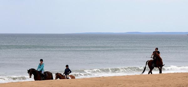 Salisbury: A trio of riders make their way up Salisbury Beach Saturday morning . Jim Vaiknoras/staff photo