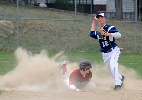 NEWBURYPORT: Triton'sBrian Whitman tries to turn a double play as  Newburyport's Colton Fontaine slides into second base during their game at Pettingell Field in Newburyport. Jim Vaiknoras/staff photo