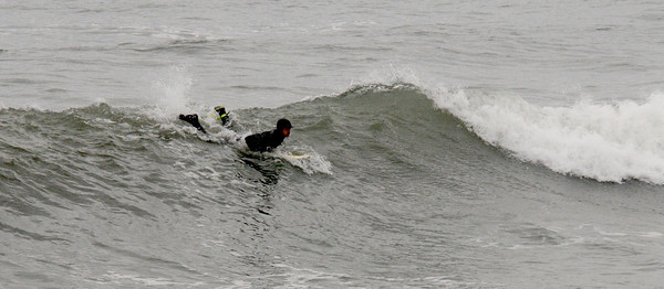 Salisbury: A surfer tries to catch a wave in the high surf off Salisbury Beach Saturday afternoon. Jim Vaiknoras/staff photo