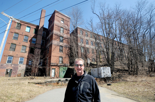 Amesbury. ARC technologies CEO Daniel Healy infront of the building at 1-9 Oakland Street in Amesbury. He is rehabing the building and will be using them to expand his business.