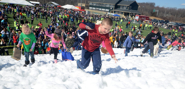 Amesbury: Kids head up the snow covered hill at the Egg Drop-Palooza at Amesbury Sports Park to benefit Lucy's Love Bus, a local nonprofit now helping young cancer patients in 12 states. Jim Vaiknoras/staff photo