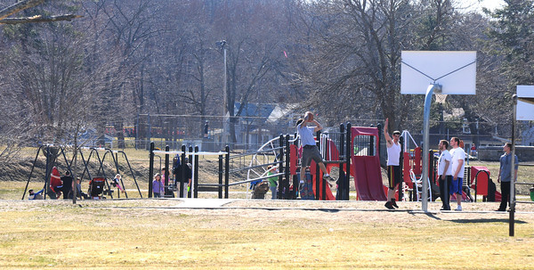 Amesbury:People take advantage of the warm weather to get some fresh air at Amesbury Park Thursday afternoon. Jim Vaiknoras/staff photo