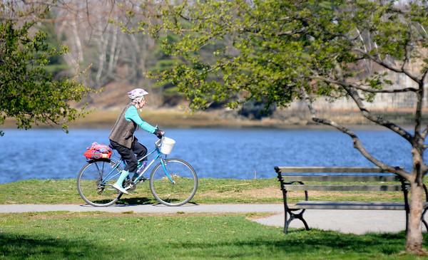 Newburyport: A cyclist takes advantage of the beautiful weather to take a spin around Cashman Park in Newbury. Jim Vaiknoras/staff photo