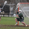 newburyport: Newburyport's Matthew Kelleher scores on Pentucket goalie Benjamin Smith during their game at World War Memorial Stadium in Newburyport Thursday afternoon. Jim Vaiknoras/staff photo