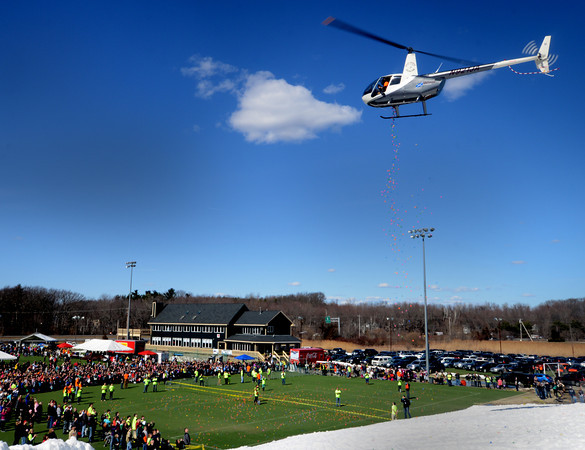 Amesbury: A helecopter from the North Andover Flight Academy lets go of its payload at the Egg Drop-Palooza at Amesbury Sports Park to benefit Lucy's Love Bus, a local nonprofit now helping young cancer patients in 12 states. Jim Vaiknoras/staff photo