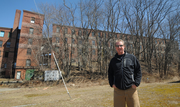 Amesbury. ARC technologies CEO Daniel Healy infront of the building at 1-9 Oakland Street in Amesbury. He is rehabing the building and will be using them to expand his business