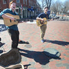 Newburyport: Carter Shelter of Byfield and Brady Moses of Rowley cast long shadows as they perform in Market Square in Newburyport Friday afternoon. Jim Vaiknoras/staff photo