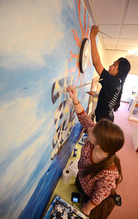 Newburyport: Newburyport high Art Honor Society Members Gabrielle Cole and Brianna Williams work on a mural in the Main Office at the high school. Jim Vaiknoras/staff photo