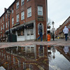 newburyport: Buildings in Market Square in Newburyport are reflected in a puddle caused by Friday night's rain. Jim Vaiknoras/staff photo