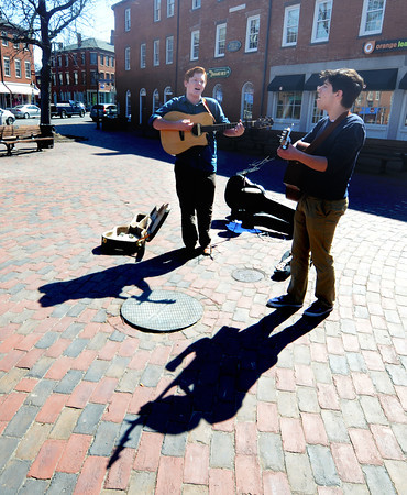 Newburyport:Brady Moses of Rowley and Carter Shelter of Byfield  cast long shadows as they perform in Market Square in Newburyport Friday afternoon. Jim Vaiknoras/staff photo