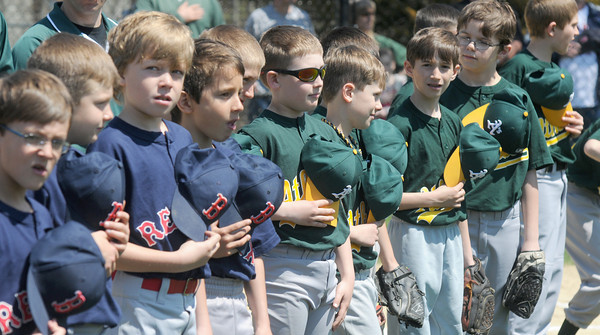 West Newbury: Members of the West Newbury Little League cover their hearts during the singing of the National Anthem Sunday at the leagues opening ceremony. JIm Vaiknoras/staff photo