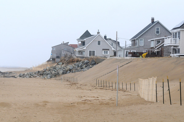 Newbury: Newly places sand covers large stones which were put down over the past month along Plum Island beach. JIm Vaiknoras/staff photo