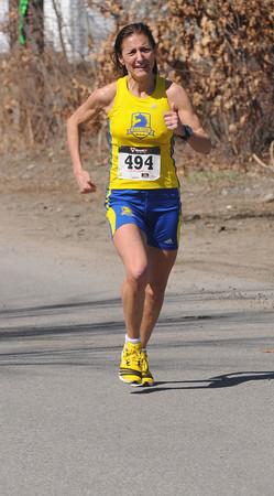 Salisbury:Mimi Fallon from Walpole, MA. wins the 32nd Annual April Fool's 4 Mile Road Race Saturday. Jim Vaiknoras/staff photo