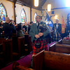 Amesbury: Gordon Webster plays the bagpipes as he leads Scottish clansfolk into St James Episcopal Church in Amesbury Sunday morning for the Kirking of the Tartans. Jim Vaiknoras/staff photo