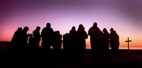 Salisbury: Members of the Market Street Baptist Church in Amesbury celebrate Easter with a sunrise service at Salisbury Beach Resurvation Sunday morning. Jim Vaiknoras/staff photo