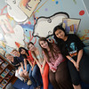 Newburyport: Advicer Aileen Maconi with Newburyport high Art Honor Society Members, Jacob Fisher, Lea Taylor, Amy Morse, Gabrielle Cole and Brianna Williams pose in front of a mural painted by them and other students in  the high school library. Jim Vaiknoras/staff photo
