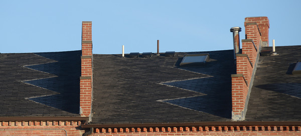 Newburyport: Shadows of fire breaks on the roofs of buidlings on State Street in Newburyport cling to frost as the morning sun warms the city. JIm Vaiknoras/staff photo