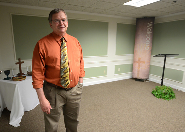 Amesbury: <br /> Seeds of Hope Mission Church Pastor Bob Ingalls stands in the church hall, located in Suite 360 of Building C in the Boston North Technical Park on Haverhill Road. Jim Vaiknoras/staff photo