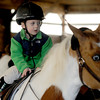 Newbury: Carter Whitney , 3, rides Ruby at the High Tail Acres in Newbury's Open House Saturday. jim Vaiknoras/staff photo
